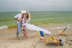 Couple resting on the beach Stock Image