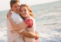Couple resting on the beach royalty free stock photos