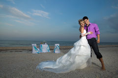 Couple resting on the beach Royalty Free Stock Image