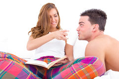 Couple resting in bed having coffee in the morning Stock Photography