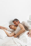 Couple resting in the bed Stock Photography