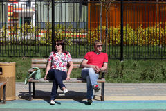 Couple resting on a bench Royalty Free Stock Image
