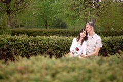 Couple resting on bench Stock Photo