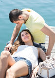 Couple resting on berth Royalty Free Stock Photo