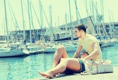 Couple resting on berth Stock Image