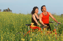 Couple resting with bicycles Stock Photos