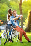 Couple resting after biking Royalty Free Stock Photos