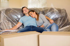 Couple resting on couch. Tired couple resting on couch in new home during moving Royalty Free Stock Photos