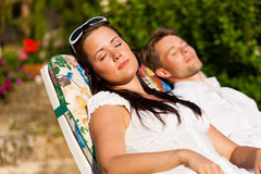 Couple resting in deck chair in summer Royalty Free Stock Photo