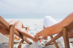 Couple resting on deck chairs Royalty Free Stock Photos