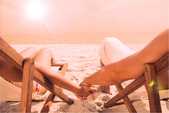 Couple resting on deck chairs Royalty Free Stock Photo