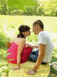 Couple resting on the Glade Stock Photo
