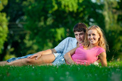 Couple resting on the grass Stock Photography