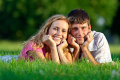 Couple resting on the grass Royalty Free Stock Image