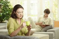 Couple resting at home Stock Images