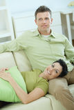 Couple resting at home Stock Photos
