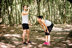 Couple resting after jogging Royalty Free Stock Photography