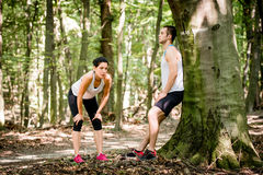 Couple resting after jogging Royalty Free Stock Photo