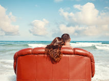 Couple resting in leather couch Royalty Free Stock Image