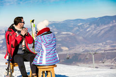 A couple is resting on lounges in picnic zone on european ski resort Stock Photos