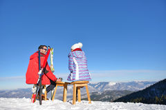 A couple is resting on lounges in picnic zone on european ski resort Royalty Free Stock Photo