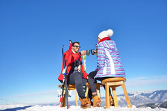 A couple is resting on lounges in picnic zone on european ski resort Royalty Free Stock Photos