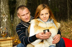 Couple resting on the nature and drinking tea Royalty Free Stock Photography