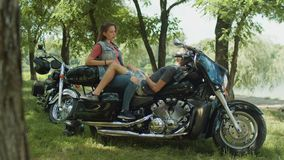 Couple resting in nature after motorcycle ride stock video