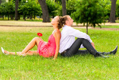 Couple resting in park Royalty Free Stock Photos