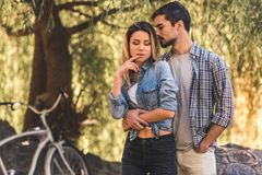 Couple resting in park Stock Images