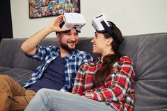 Couple resting after playing virtual reality computer games Stock Image