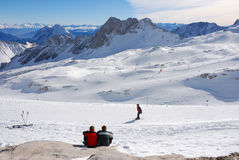 Couple resting in skiing area Stock Images