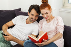 Couple Resting on the Sofa at the Living Room Royalty Free Stock Photography