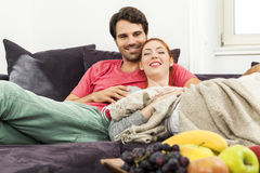 Couple Resting on the Sofa at the Living Room Stock Image