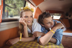 Couple resting in van Stock Images