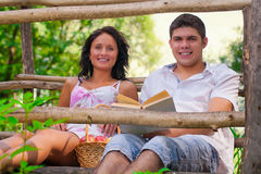 A couple resting on wooden bridge Stock Images