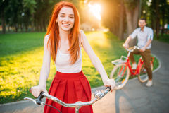 Couple on retro bicycles on sunset, romantic date Royalty Free Stock Photo