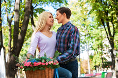 Couple with retro bike in park. Royalty Free Stock Photo