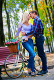 Couple with retro bike in the park Royalty Free Stock Photo