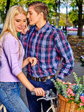 Couple with retro bike in the park Royalty Free Stock Photography