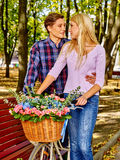 Couple with retro bike in the park Stock Photos