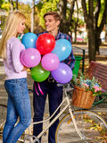 Couple with retro bike in the park Royalty Free Stock Image