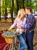 Couple with retro bike in park. Stock Photography