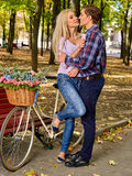 Couple with retro bike in the park Royalty Free Stock Photos