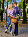Couple with retro bike in the park Stock Photography