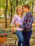 Couple with retro bike in the park Stock Images