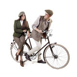 Couple on retro bike Stock Photos