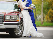 Couple at Retro Car Stock Photo