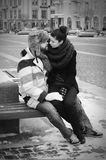 A couple in retro style kissing. Women and men friends or lovers posing, bw Stock Photography