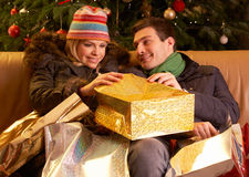 Couple Returning After Christmas Shopping Trip Stock Photo